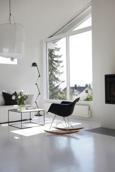 Black and white living area with loads of natural light