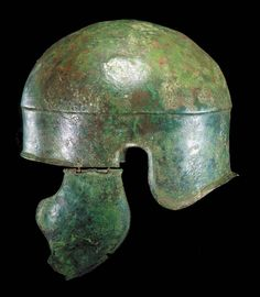 A GREEK BRONZE HELMET  CIRCA 4TH CENTURY B.C.