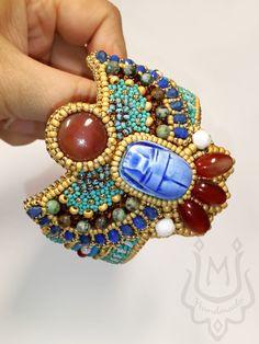 Браслет жесткий: Браслет в египетском стиле со скарабеем и сердоликом – заказать на Ярмарке Мастеров – KD6BYRU | Браслет жесткий, Санкт-Петербург Fashion Bracelets, Cuff Bracelets, Fashion Jewelry, Handmade Necklaces, Handmade Jewelry, Bead Embroidered Bracelet, Ancient Egyptian Jewelry, Beaded Boxes, Carnelian