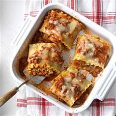 Lasagna Rolls Recipe -Folks can't believe these flavor-filled rolls have just five ingredients. Using prepared spaghetti sauce saves me lots of cooking time. My family never complains when these appear on the table.