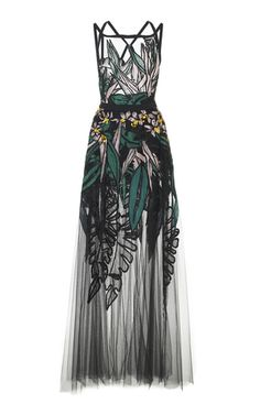 This **Elie Saab**dress features embroidery throughout crisscross straps on back, and pockets at hip.
