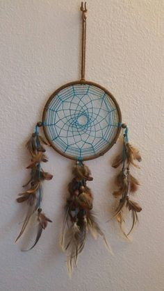 Hey visit my etsy shop!! Etsy listing at https://www.etsy.com/listing/250599961/vibrant-blue-and-brown-dream-catcher-6