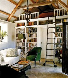 Cottage with Book Shelves >> It has always been my dream to have a library with a ladder.