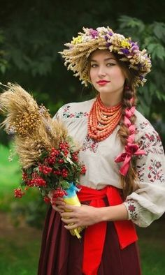 Ukrainian woman wearing a folk costume with traditional embroidery and floral headdress, Ukraine Costume Ethnique, Floral Headdress, Costumes Around The World, Beauty Around The World, Folk Costume, World Cultures, People Around The World, Traditional Dresses, Beautiful People