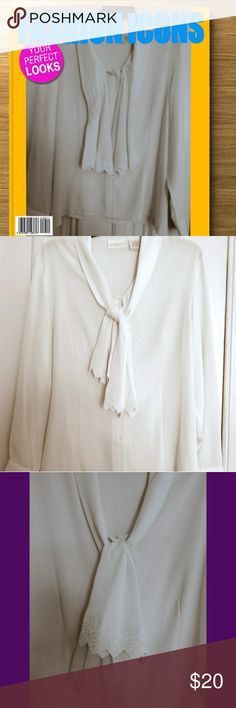 Jaclyn Smith classic blouse & jabot tie accessory 😍 Beautiful classy pure white blouse from Jaclyn Smith. Has an amazing silken feel but made of 100% polyester. The squared button mother of pearl coloring adds a bit of uniqueness that takes away from that boring blouse look. Also as an even more stylish touch there's an embroidered Jabot tie extended from the collar. The condition is excellent no spots no off color areas, pic is in low light but the blouse is pure bright white, not worn…