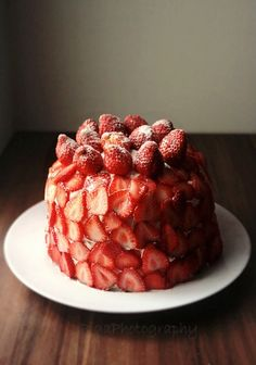 Can't wait to try making this!  Strawberry crepe cake  = stack of crepes with icing filling, covered in strawberries.