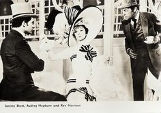 https://flic.kr/p/QXeSRb | Audrey Hepburn, Jeremy Brett and Rex Harrison in My Fair Lady (1964) | East-German postcard by VEB-Progress Film-Vertrieb, Berlin, no. 2989. Retail price: 0,20 MDM. Photo: Warner Bros. Publicity still for My Fair Lady (George Cukor, 1964). Costumes: Cecil Beaton.  Elegant, talented and funny Audrey Hepburn (1929-1993) was a Belgian-born, British-Dutch actress and humanitarian. After a start in the European cinema she became one of the most successful Hollywood…