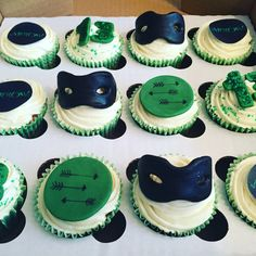 Arrow TV Show Stephen Amell Cupcakes Birthday Green and Black Colour Scheme with Glitter and Ivory Vanilla Buttercream. Toppers are Arrow Direction Discs, Logo Age and Mask
