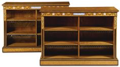 A pair of Victorian gilt-brass and jasperware mounted boxwood and ebony strung satinwood and amaranth open bookcases circa 1870, in the manner of Holland & Sons the frieze with Wedgewood type plaques depicting classical scenes and inlaid with draped swags, enclosing four adjustable shelves with later leather lambrequin trim, the uprights headed with gilt-brass floral bouquets, on a plinth base