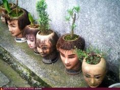 Ever wonder what happens to all the practice heads used at beauty schools? I never really put much thought into it. Slightly creepy (perfect for Halloween!), these potted heads were spotted outside of a salon in Japan. Halloween Crafts, Halloween Decorations, Halloween Ceiling, Halloween Window, Spooky Halloween, Halloween Costumes, Mannequin Art, Head Planters, Fall Planters