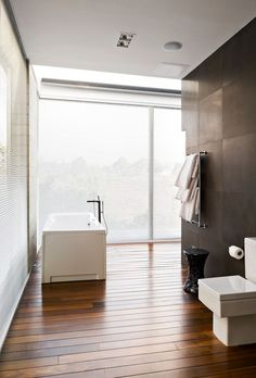 Architecture. Splendid Glass Wall for Home Enhancing Modern Architecture Style: Appealing Relaxing And Light Modern Bathroom Design With White Square Bath Up And Closet ~ wegli