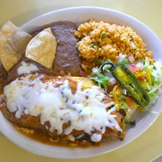 Our Chile Relleno: Poblano stuffed w/ picadillo or queso blanco. Topped w/ ranchero sauce and cheese. Served 11am - close.  Full menu at: www.ElMilagritoCafe.com