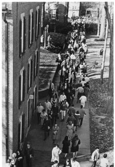 Bird's eye view of students streaming past Wilson Hall (Administration), 1960s mid :: Ohio University Archives
