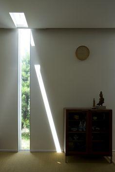 narrow floor to ceiling window