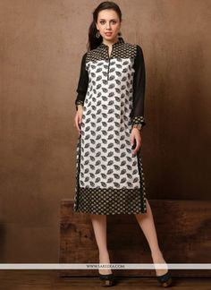 We unfurl our the intricacy and exclusivity of our creations highlighted in this black and white cotton   party wear kurti. The print work on dress personifies the whole appearance. (Slight variation ...