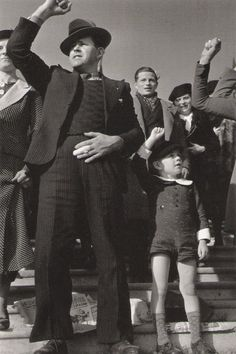 Robert Capa © International Center of Photography FRANCE. Paris. October 1936. Man and boy at Popular Front rally.