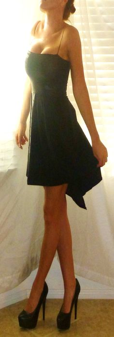 CLASSIC LIL' BLACK DRESS ... perfect.  Simple spagetti strap, 100%stretch pushup/supportive tube top w/slight metalic sheen, silky flowy skirt longer in back, sexy side leg slit ... wear with hot blazer, silky or sheer blouse, alone or throw on fav sweater and highest boots ... essential, classic, classy