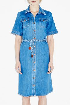 """14 London It Girls Reveal Their Spring Must-Haves #refinery29  http://www.refinery29.com/london-spring-fashion-wish-list#slide-8  """"I can't get enough denim at the moment, and MiH have long been a favourite of mine, so I am popping this dress into my shopping basket. It will work well for this season's '70s trend, but that won't stop me from wearing it year in, year out. It's a classic.""""  MiH '70s Denim Dress, £295, available at MiH."""