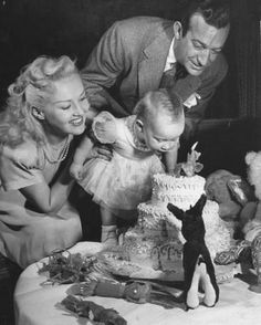 Betty Grable & Harry James with their daughter Victoria in 1945. A great image...