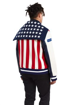 Opening Ceremony, USA Varsity Jacket The U.S.A. jacket sports all the iconic elements of the American flag—a star spangled sailor hood with the iconic red and white stripes down the back, which represent the former thirteen colonies., Unisex, Front snap button closures, Leather sleeves, Ribbed cuffs and hem, Leather trimmed side pockets, Body: 80% wool, 20% nylon; sleeves: 100% leather, Imported