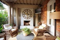 Atchison Home | Outdoor Living Room | Concrete Fireplace | Big Clock