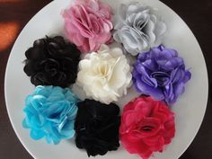 Posh satin & tulle roses on an alligator clip or headband!! Light pink, silver, brown, ivory, purple, turquoise, black and hot pink colors in stock but more colors available! SO CUTE as a photo prop too! Visit my etsy shop for details and purchasing =) www.stephanieb77.etsy.com