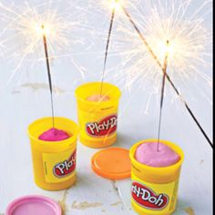 Stick a sparkler in Play-Doh, then light it up. The container protects hands from flying sparks, preventing burns.