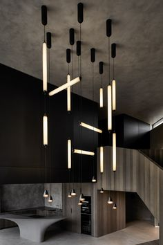 The contrast of minimalistic vertical and horizontal light tubes with single bell lights plays boldly off this dramatic interior by the architects of Labor author of interior: architekti photo: Martin Chum Interior Lighting, Lighting Design, Dj Lighting, Ceiling Light Design, Ceiling Lights, Wardrobe Door Designs, Hand Blown Glass, Pendant Lamp, Contrast