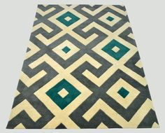 "A custom hand tufted pure wool rug in ivory white, light teal green and silver grey. It has a pile depth of 12-14mm. Created using the ""Alamo"" design. #CustomRugRoom"