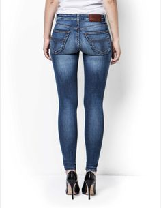 SLIGHT jeans - Women's light blue,mid-waist, super-slim leg, five-pocket jeans in 12-ounce denim. The wash is called Wendy and is a mid to light blue wash with aggressive whiskering and signs of wear and wash. The high and low in blue tones are contrasted to give these a lot of 3d effect while there is barely any indigo left in the scrapings on thighs and knees. Classic styling with tobacco stitching and oxidized copper finish in button and rivets. Leather logo label on waistband.
