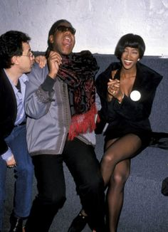 ANDRÉ LEON TALLEY  Year Inducted: 1994 - Style Hallmarks: The ostentatious, trunk-carrying, caftan-wearing Vogue contributor was first a style editor for Vanity Fair—he's shown here laughing with model Naomi Campbell at a 1989 party in New York.