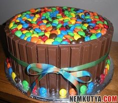 Kit Kat Cake Take a break! Have a kit kat cake. the Kit Kat Cake is a chocolate cake surrounded by fence of Kit Kat and topped with cadbury's gems. An absolute delicacy for chocolate lovers.