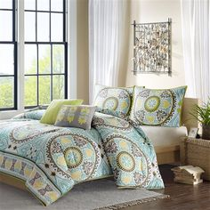 Get a taste of Indonesia in your bedroom with the Kazan Comforter and Decorative Pillow Set by Home Essence. The polyester comforter and shams feature dusty shades of green, teal, brown and yellow in this beautiful medallion motif that repeats across the comforter and shows up centered on each sham. The dusty green color continues on the reverse of the comforter and shams. Two decorative pillows are included in this amazing global set!