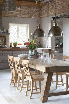Nice matching of upper wall tiles with chunky wooden table . Spot the Belfast sink and bridge mixer kitchen tap in the corner - lovely :)