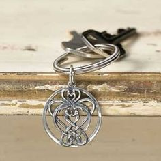 Sisters Celtic Knot Keychain The continual looping of this Celtic knot on this keychain represents love and the never-ending bond of sisterhood. Symbol Tattoos, New Tattoos, I Tattoo, Cool Tattoos, Tatoos, Awesome Tattoos, Heart Tattoos, Wrist Tattoo, Celtic Symbols