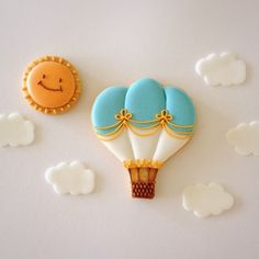 Sugar Cookie Decorated with Royal Icing Hot Air Balloon and Smiling Sun.