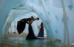 """Photo by James Ewing of Shen Wei's site-specific dance installation in Armory Park, 2009.  In site-specific art installation by Ernesto Neto, """"anthropodino""""."""