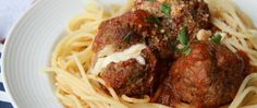 """Nothing says """"home cooking"""" like a good plate of meatballs. Tiny balls of fresh mozzarella are the """"surprise inside"""" this hearty dish, which uses the slow cooker as a prep shortcut."""