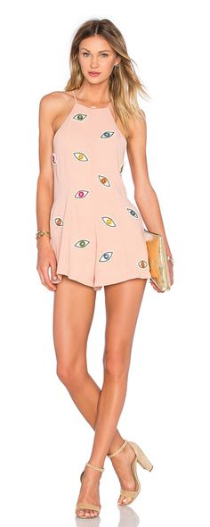 Eyes on me romper by NBD. Poly blend. Hand wash cold. Embroidered graphic with bead and rhinestone accent. Hidden back zipp...