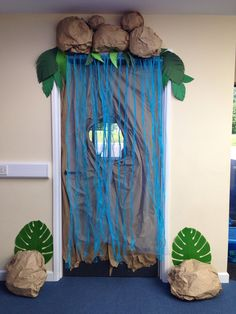 Lokaal inrichten ~leuke welkom voor de clubs~ Safari / Jungle - Waterfall entry way. Going to use a mixture of white, light & dark blue plastic table cover Rainforest Classroom, Dinosaur Classroom, Jungle Theme Classroom, Rainforest Theme, Classroom Door, Classroom Design, Classroom Displays, Classroom Themes, Classroom Crafts