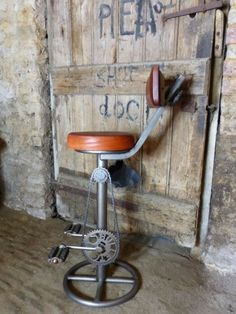 Vintage, Industrial Bike Bar Stool. Our Universal designer brown leather stools can be used in a bar, kitchen or as a counter stool in a shop.