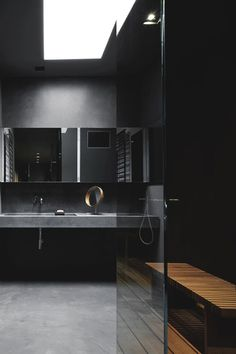 A very chic and sexy, masculine, minimalist bathroom in black slate and concrete.