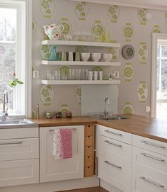 white kitchen with wooden bench top