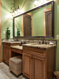 Light wood cabinetry illuminates this traditional bathroom. The green walls provide a nice contrast with the brown countertops.