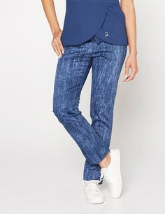 The Skinny Pant in Denim Print is a contemporary addition to women's medical scrub outfits. ShopJaanuufor scrubs, lab coats and other medical apparel.