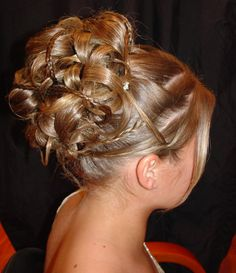 Curly Updo for flower girls | Wedding braid updo with long side bangs with white small flowers.PNG