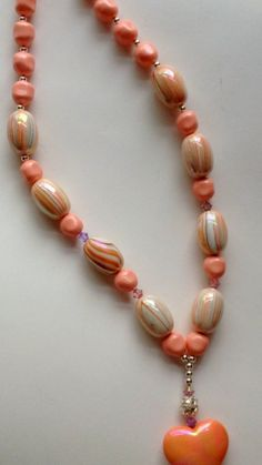 Items similar to Valentine's Day necklace with peach acrylic beads, peach acrylic heart, swarovski crystals and baroque pearls. on Etsy Beaded Necklace, Beaded Bracelets, Acrylic Beads, Baroque Pearls, Swarovski Crystals, Peach, Unique Jewelry, Handmade Gifts, Etsy