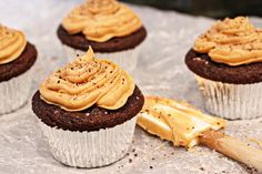 Recipe for homemade dark chocolate cupcakes. Fluffy and moist cupcakes topped with a creamy peanut butter frosting!