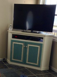 """Corner tv stand refinished with chalk paint - aged with dark wax - add cute """"anchor"""" handles - perfect in the beach house"""