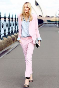 A pink suit is paired with a chambray, black ankle strap heels and a leopard print clutch.